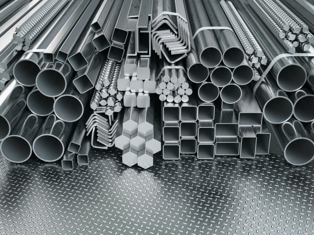 Stainless steel profiles and tubes. in warehouse background. Different metal rolled products.